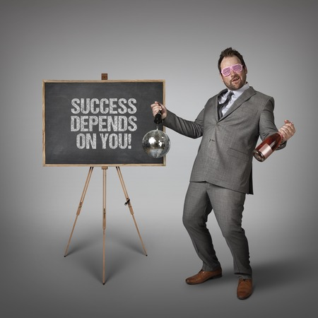 depends: Success depends on you text on  blackboard with drunk businessman Stock Photo