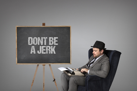 foolishness: Dont be a jerk text on  blackboard with businessman sitting on armchair