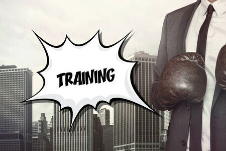 rehearsal: Training text on speech bubble with businessman wearing boxing gloves Stock Photo