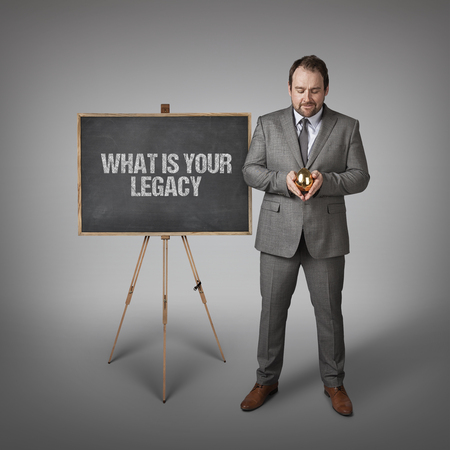 legacy: What is your legacy text on  blackboard with businessman and golden egg Stock Photo