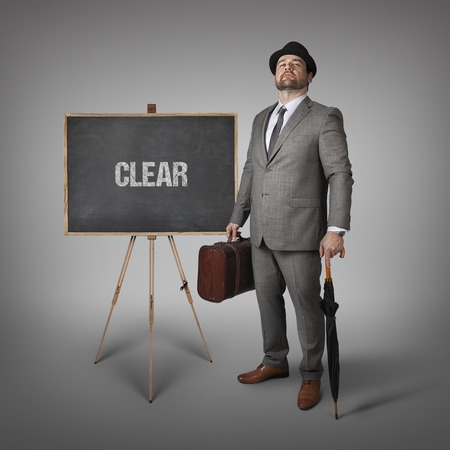 unblemished: Clear text on blackboard with businessman and key
