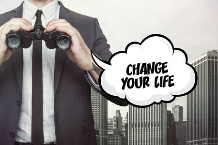 life change: Change your life text on cloud with businessman and Binoculars