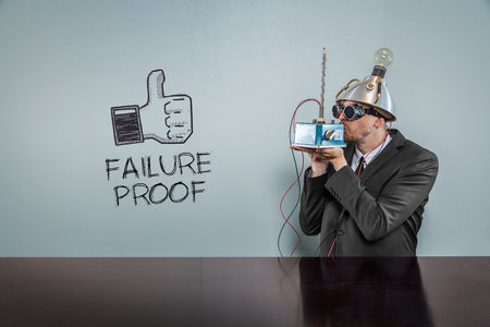corroboration: Failure proof text with vintage businessman kissing machine Stock Photo