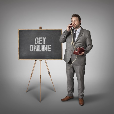 admirers: Get online text on blackboard with businessman holding phone
