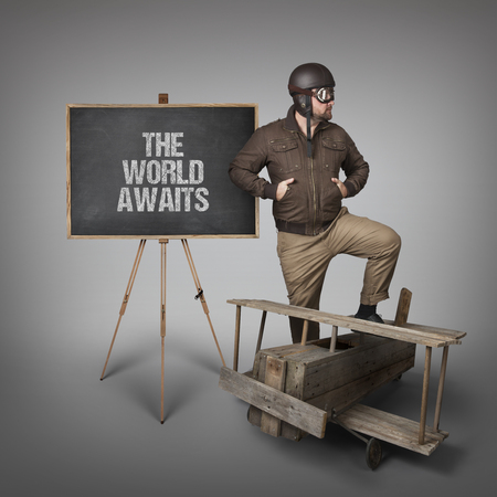 expects: The world awaits text on  blackboard with businessman and wooden plane