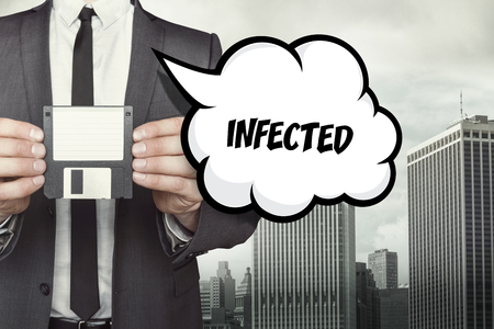 infected: Infected text on speech bubble with businessman holding diskette Stock Photo