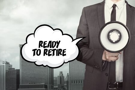 retire: Ready to retire text on speech bubble with businessman holding megaphone Stock Photo