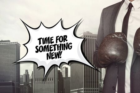 undertake: Time for something text on speech bubble with businessman wearing boxing gloves