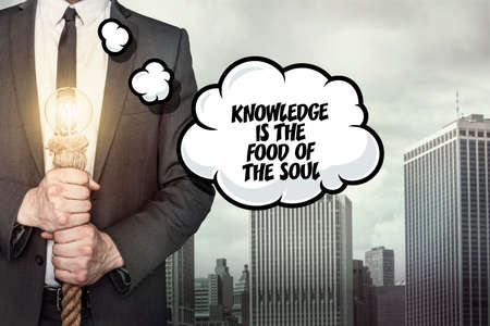 acquaintance: Knowledge is the text on speech bubble with businessman holding lamp Stock Photo
