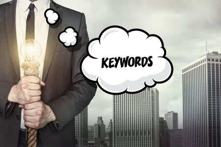 keywords bubble: Keywords text on speech bubble with businessman holding lamp