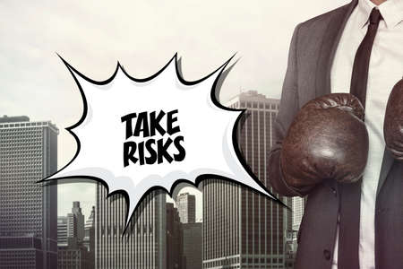 probability: Take risks text on speech bubble with businessman wearing boxing gloves