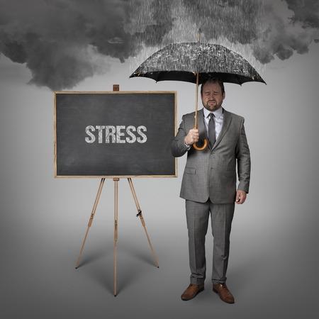 rehabilitated people: stress text on blackboard with businessman holding umbrella Stock Photo