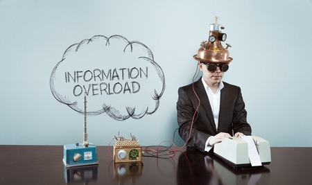 Cloud information overload text with vintage businessman and calculator at office Standard-Bild