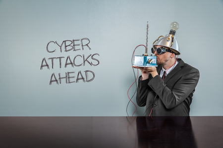 cyber attacks: Cyber attacks ahead text with vintage businessman kissing machine