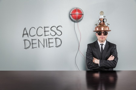 disagreed: Access denied text with vintage businessman and alert light