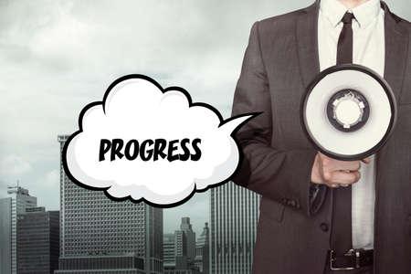 growth enhancement: Progress text on speech bubble with businessman holding megaphone Stock Photo