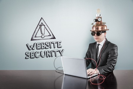 safekeeping: Website security text with vintage businessman using laptop at office