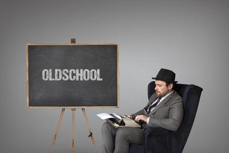 oldschool: Oldschool text on blackboard with businessman