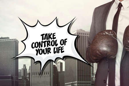 acquire: Take control of text on speech bubble with businessman wearing boxing gloves Stock Photo