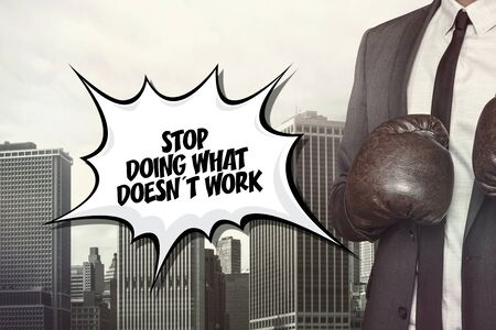 discontinue: Stop doing what text on speech bubble with businessman wearing boxing gloves