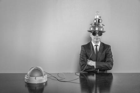 Vintage businessman sitting at office desk with alert light Stock Photo