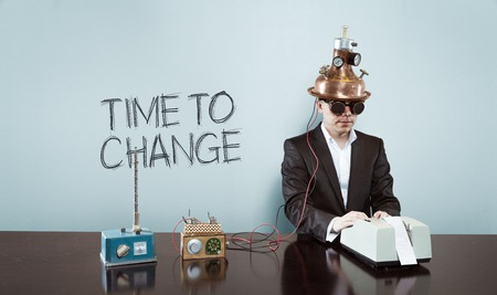 revision: Time to change text with vintage businessman and calculator at office Stock Photo