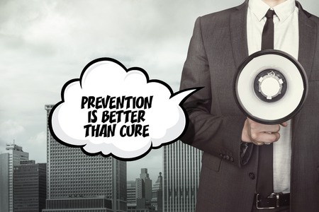 than: Prevention is better than cure text on speech bubble with businessman holding megaphone