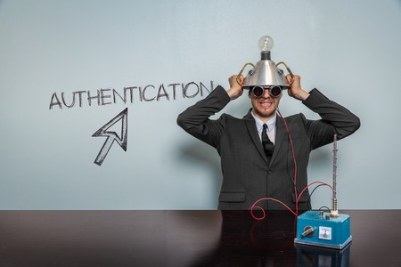 authentication: Authentication text with vintage businessman and machine at office