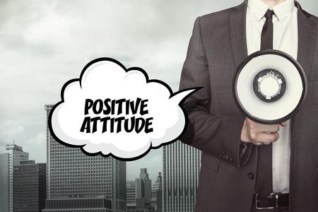 attitude: Positive attitude text on speech bubble with businessman holding megaphone Stock Photo
