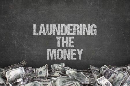 rightful: Laundering the money text on black background with dollar pile