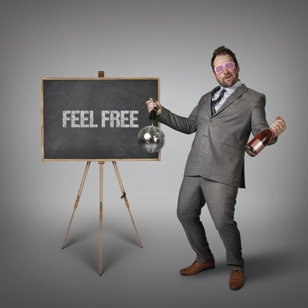 unrestricted: Feel free text on  blackboard with drunk businessman Stock Photo