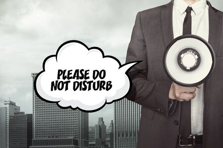 Please do not disturb text on speech bubble with businessman holding megaphone Stock Photo