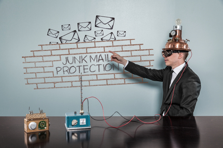 unsolicited: Junk Mail Protection concept with vintage businessman pointing hand Stock Photo