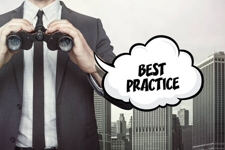 Best Practice text on  blackboard with businessman and key