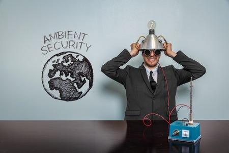 ambient: Ambient Security text with vintage businessman and machine at office