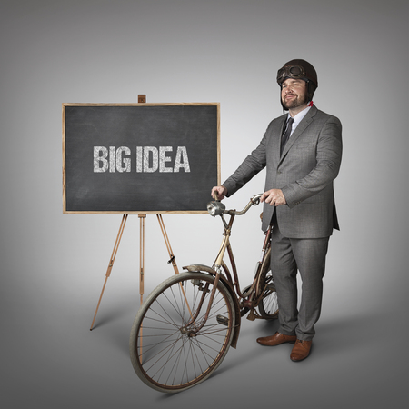 conceptions: Big idea text on blackboard with businessman Stock Photo
