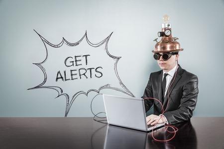 alerts: Get alerts text with vintage businessman using laptop