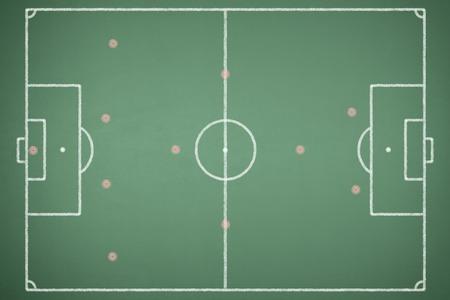 Green blackboard with soccer field Stock Photo