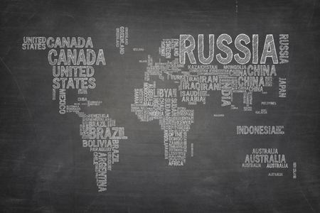World map composed from country names on black blackboard