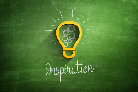 Light bulb icon and inspiration text on blackboard