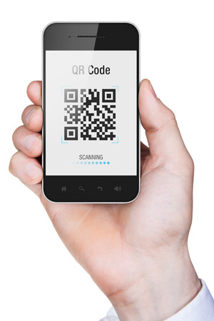 Businessman hand holding a mobile phone with qr code on screen