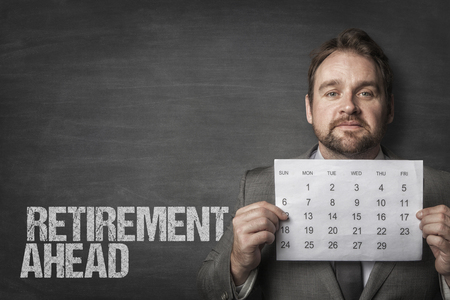 Retirement ahead text with businessman Imagens