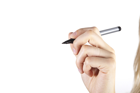 Woman hand holding a pen isolated on white Imagens