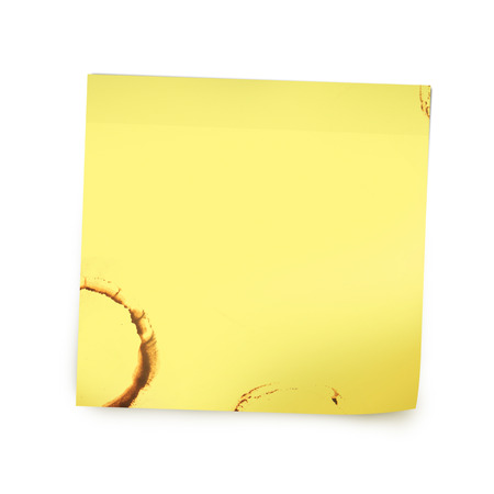 Yellow reminder note paper with coffee stain