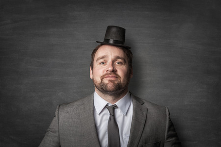 Funny businessman wearing a cylinder hat Imagens