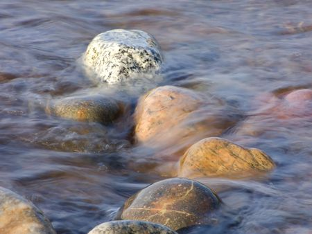 inflow: Nature. Sea. Waves of inflow washing waterside stones Stock Photo
