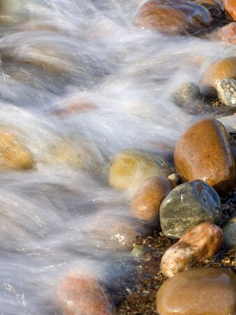 inflow: Nature. Sea. Waves of inflow washing waterside stones Stock Photo