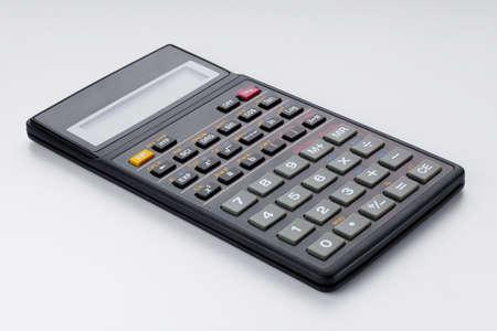 Scientific calculator isolated on white photo