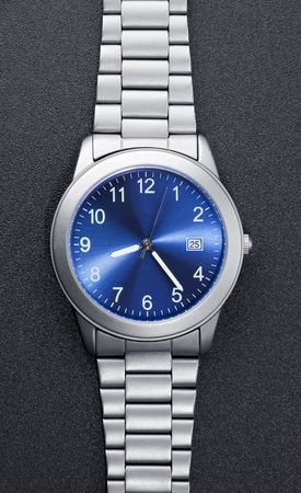 Stainless steel watch on black photo