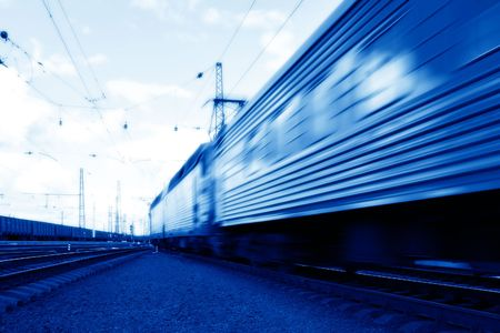 Blue speed train in motion concept photo